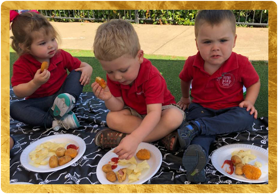 cute toddlers eating outdoors at a Preschool & Childcare Center Serving Keller, TX